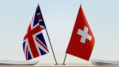 Συμφωνία για συνέχιση των εμπορικών τους σχέσεων μετά το Brexit υπέγραψαν Βρετανία - Ελβετία