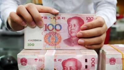 Κίνα: Στα 7,0211 γουάν/δολάριο η ισοτιμία αναφοράς από την κεντρική τράπεζα